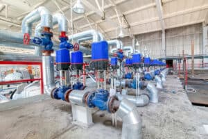 Steel pipelines and valves on modern new factory producing blocks